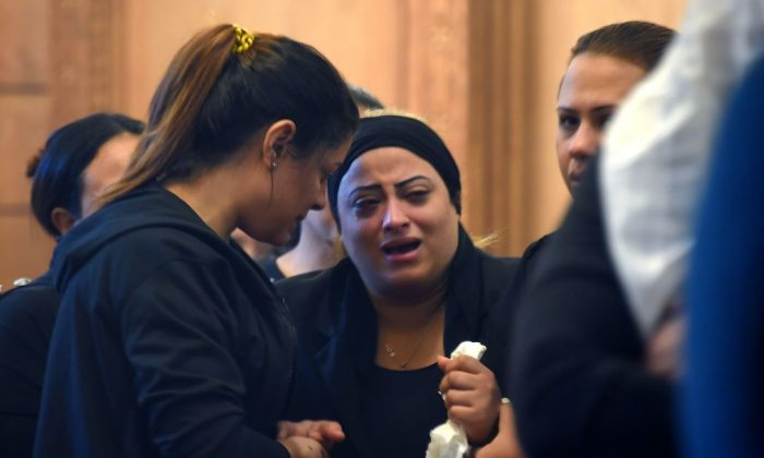 A Coptic Christian woman mourns victims killed in an attack a day earlier, during an early morning ceremony at the Prince Tadros church in Egypt's southern Minya province, on November 3, 2018. MOHAMED EL-SHAHED/AFP/Getty Images