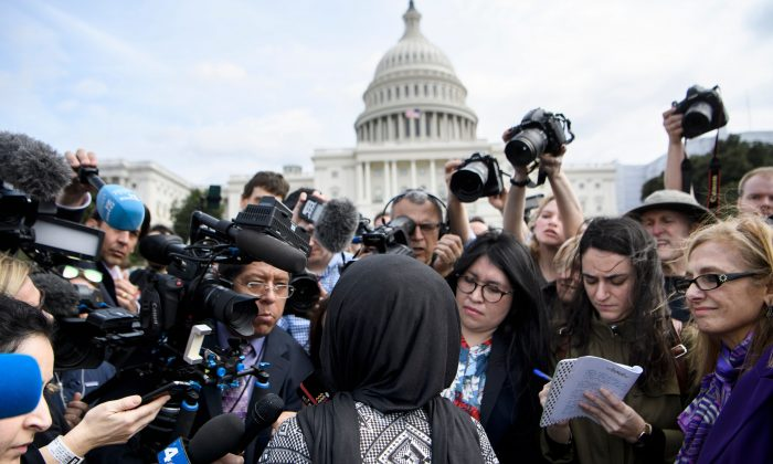 Rep. Ilhan Omar (D-MN) speaks to reporters during a youth climate rally on the west front of the Capitol in Washington on March 15, 2019. (BRENDAN SMIALOWSKI/AFP/Getty Images)