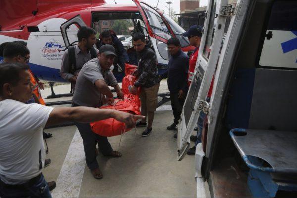 officials unload bodies