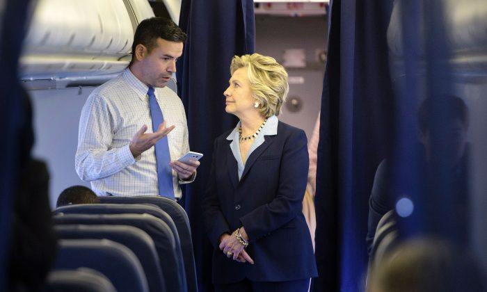 Democratic presidential nominee Hillary Clinton and national press secretary Brian Fallon on  her plane at Westchester County Airport in White Plains, N.Y., on Oct. 3, 2016. (BRENDAN SMIALOWSKI/AFP/Getty Images)