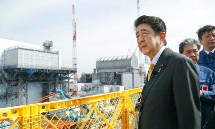 Japanese Prime Minister Shinzo Abe visits Fukushima Dai-ichi nuclear power plant in Okuma, Fukushima prefecture, Japan, on April 14, 2019. (Kyodo News via AP)