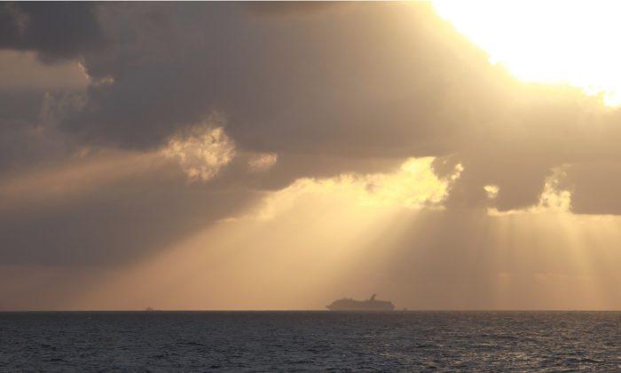 U.S. Coast Guard reaching out to help crippled cruise ship in Gulf Of Mexico, on Feb. 12, 2013. (file Photo/ Chris Shivock/U.S. Coast Guard via Getty Images)