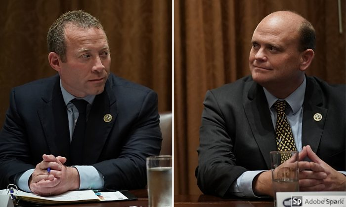 Rep. Josh Gottheimer (D-N.J.) (L) and Rep. Tom Reed (R-N.Y.) in Washington on Sept. 13, 2017.  (BRENDAN SMIALOWSKI/AFP/Getty Images)