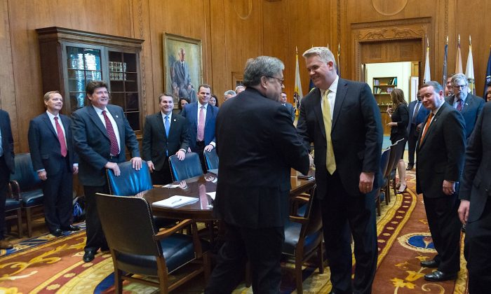 Attorney General William Barr shakes hands with U.S. Attorney John Huber at the Justice Department in Washington, D.C., in March, 2019. (Courtesy Justice Department)