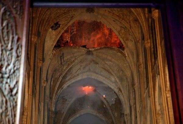 Flames and smoke as the interior of the Notre Dame Cathedral continued to burn