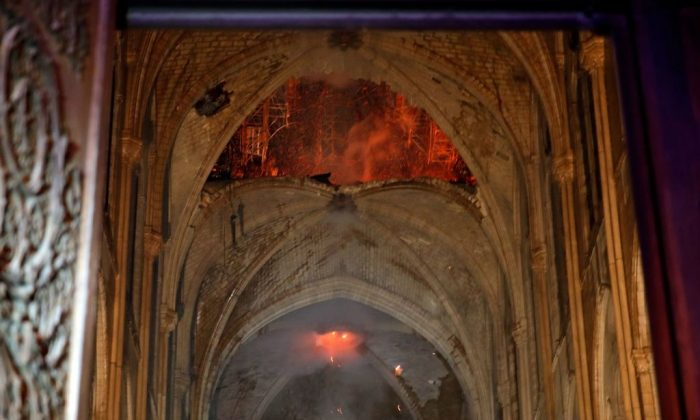 Flames and smoke are seen as the interior of the Notre-Dame Cathedral continued to burn on April 15, 2019. (Philippe Wojazer/AFP/Getty Images)