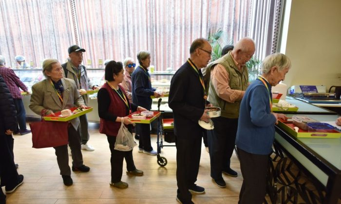 Residents lining up for lunch at the Yanyuan community center for senior citizens, on the outskirts of Beijing, on December 5, 2018.  (GREG BAKER/AFP/Getty Images)