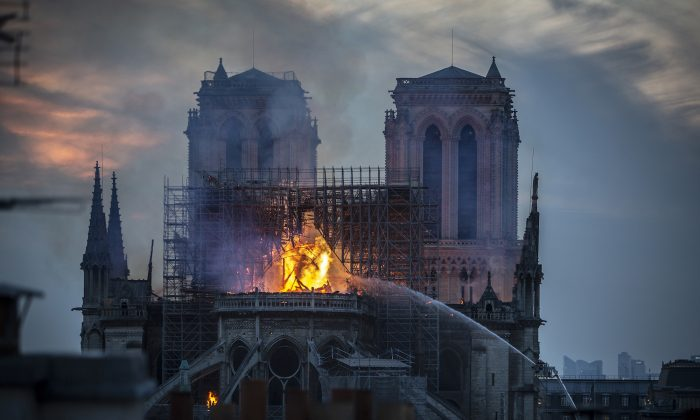 Smoke and flames rise from Notre-Dame Cathedral in Paris, France, on April 15, 2019. (Veronique de Viguerie/Getty Images)