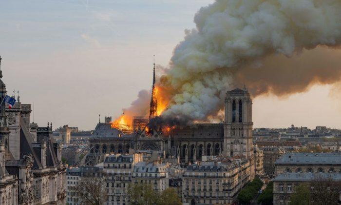 Smoke billows as flames burn through the roof of the Notre Dame de Paris Cathedral in Paris, on April 15, 2019. (Fabien Barrau/AFP/Getty Images)