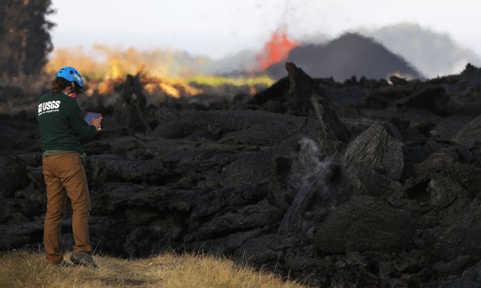 A U.S. Geological Survey geologist inspects lava on Big Island, Hawaii, on May 19, 2018. (Mario Tama/Getty Images)