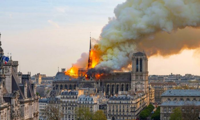 Smoke billows as flames burn through the roof of the Notre-Dame de Paris Cathedral in the French capital of Paris, on April 15, 2019. (Fabien Barrau/AFP/Getty Images)
