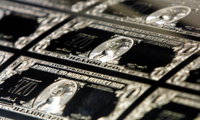 The plates used to print the new Series 2001 one dollar bill notes are stored at the Bureau of Engraving and Printing in Washington on Nov. 21, 2001. (Alex Wong/Getty Images)