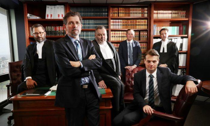 Former JCU geophysicist Peter Ridd with his legal team. (Peter Ridd/IPA)