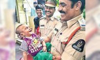 4-Month-Old Baby Flashes Toothy Grin to Cop Who Rescued Him From Kidnappers