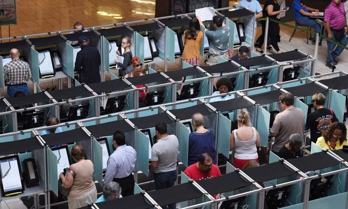 People vote on the first day of early voting in Las Vegas on Oct. 20, 2018.  Ethan Miller/Getty Images