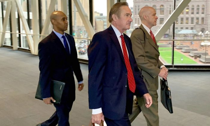 Former Minneapolis police officer Mohamed Noor left, arrived with his defense attorneys Peter Wold, center, and Thomas Plunkett, right, before another day of testimony in Noor's murder and manslaughter trial in Minneapolis on April 17, 2019.  (Jeff Baenen/AP Photo)