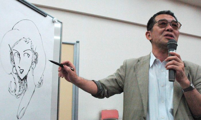 This June 2004, photo shows cartoonist Monkey Punch drawing his character Fujiko Mine on a whiteboard at a symposium in Nishinomiya, western Japan. (Kyodo News via AP)