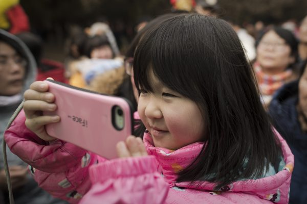 A girl with a smartphone in Beijing on Feb. 17 2018