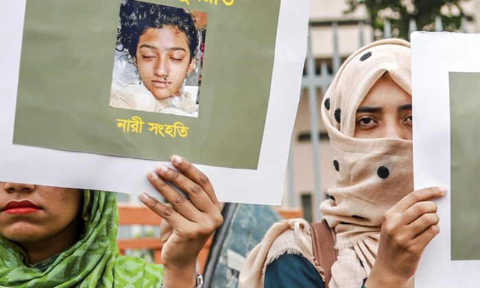 Bangladeshi women hold placards and photographs of schoolgirl Nusrat Jahan Rafi at a protest in Dhaka, on April 12, 2019. (Sazzad Hossain /AFP)