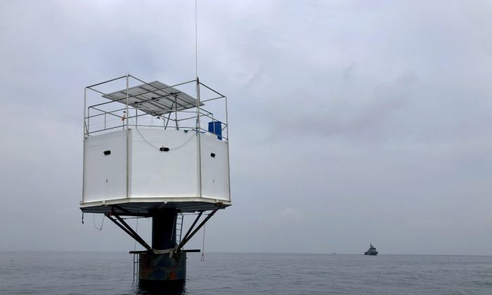 Thai authorities raided a floating home lived in by an American man and his Thai partner off the coast of Thailand, on April 13, 2019.(Royal Thai Navy via AP)