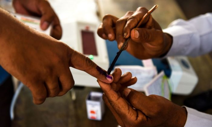 An Indian voter gets her finger marked with ink at a polling station during India's general election in Shahpur, Uttar Pradesh, on April 11, 2019. (Money Sharma/AFP/Getty Images)