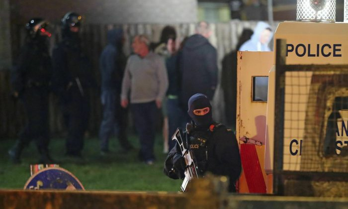Armed police stage at the scene of unrest in Creggan, Londonderry, in Northern Ireland, on April 18, 2019. (Niall Carson/PA via AP)