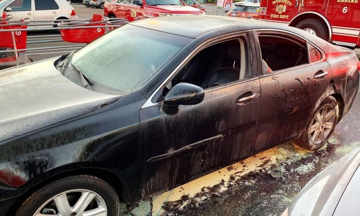 A car damaged by fire in the parking lot of a Target store in Modesto, Calif., on April 17, 2019. (Modesto Fire Department)