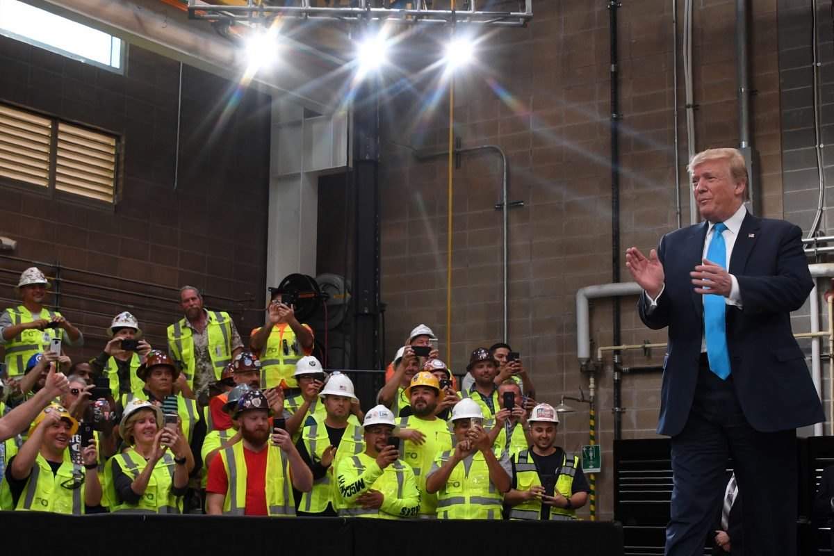 President Donald Trump arrives to sign executive orders on energy and infrastructure at the International Union of Operating Engineers International Training and Education Center in Crosby