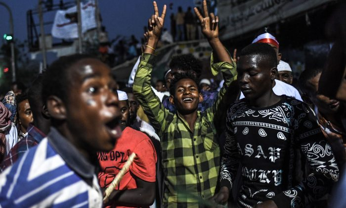 Sudanese protesters shout slogans during a protest outside the army headquarters in the capital Khartoum on April 19, 2019. (Ozan Kose/AFP/Getty Images)
