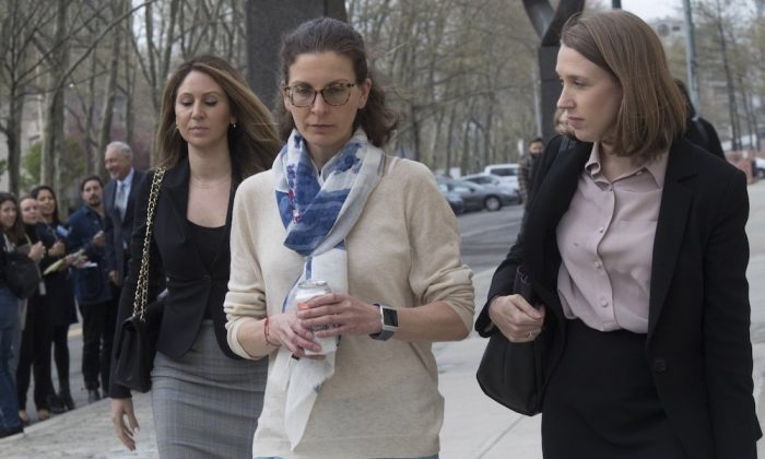 Clare Bronfman (C), leaves Federal court in the Brooklyn borough of New York, on April 19, 2019. (Mary Altaffer/AP Photo)