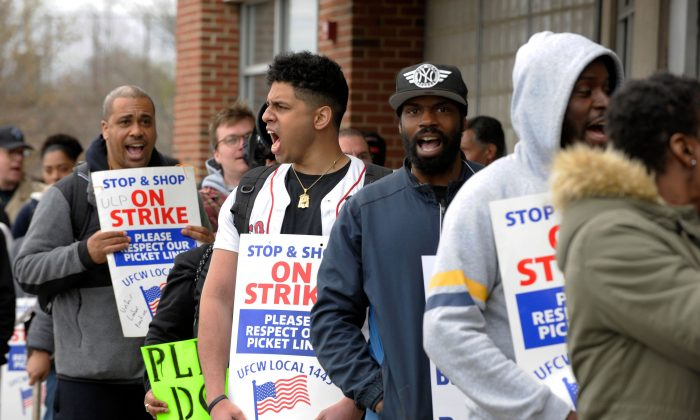 Stop and Shop workers and supporters march in a picket line at the Stop and Shop South Bay Plaza's entrance at a rally organized by UFCW Union members and attended by former US vice president Joe Biden to support Stop and Shop employees on strike throughout the region at the Stop and Shop in Dorchester, Massachusetts, on April 18, 2019. JOSEPH PREZIOSO/AFP/Getty Images