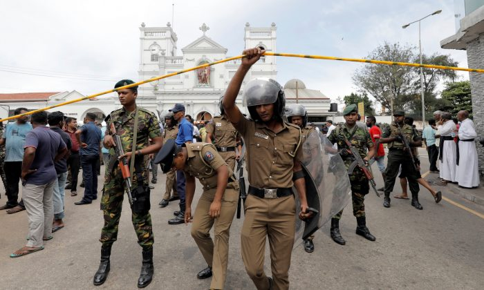 Sri Lankan military officials in front of St. Anthony's Shrine, Kochchikade church after an explosion in Colombo, Sri Lanka, on April 21, 2019. (Dinuka Liyanawatte/Reuters)