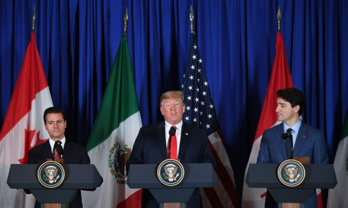 (L to R) Mexican President Enrique Pena Nieto, U.S. President Donald Trump, and Canadian Prime Minister Justin Trudeau deliver a statement on the signing of the USMCA trade agreement in Buenos Aires on the sidelines of the G20 Leaders' Summit, on Nov. 30, 2018. (MARTIN BERNETTI/AFP/Getty Images)