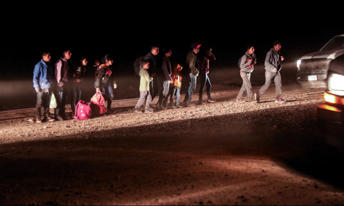 Border Patrol processes 13 Guatemalans who illegally crossed the Colorado River from Mexico into the United States in Yuma, Ariz., on April 14, 2019. (Charlotte Cuthbertson/The Epoch Times)