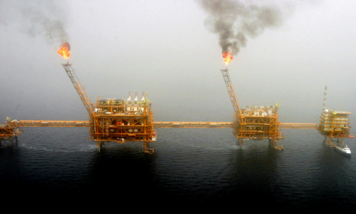 Gas flares from an oil production platform at the Soroush oil fields in the Persian Gulf, south of the capital Tehran, on July 25, 2005. (Raheb Homavandi/File Photo/Reuters)