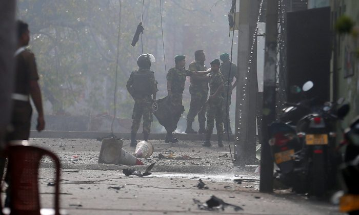 A SECTION_NYC A SECTION_NYC 100% 10  Special Task Force Bomb Squad officers inspect the site of an exploded van near a church that was attacked in Colombo, Sri Lanka, on April 22, 2019. REUTERS/Dinuka Liyanawatte Screen reader support enabled.     https://admin4...7&action=edit    Special Task Force Bomb Squad officers inspect the site of an exploded van near a church that was attacked in Colombo, Sri Lanka, on April 22, 2019. REUTERS/Dinuka Liyanawatte