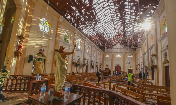 A view of St. Sebastian's Church damaged in blast in Negombo, north of Colombo, Sri Lanka, Sunday, April 21, 2019/ (AP Photo/Chamila Karunarathne)
