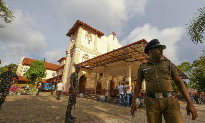 Sri Lankan army soldiers secure the area around St. Sebastian's Church damaged in blast in Negombo, north of Colombo, Sri Lanka, on April 21, 2019.  (Chamila Karunarathne/AP Photo)