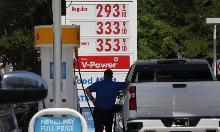 A motorist gets gas for his vehicle at a station in Miami, Florida, on April 1, 2019. (Joe Raedle/Getty Images)