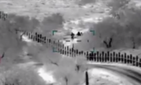 Video Shows Armed Men Escorting Mother and Son Across US Border
