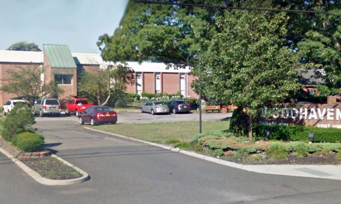 The entrance to Woodhaven Care Center in Port Jefferson Station, New York, in July 2018. (Screenshot/Google Maps)