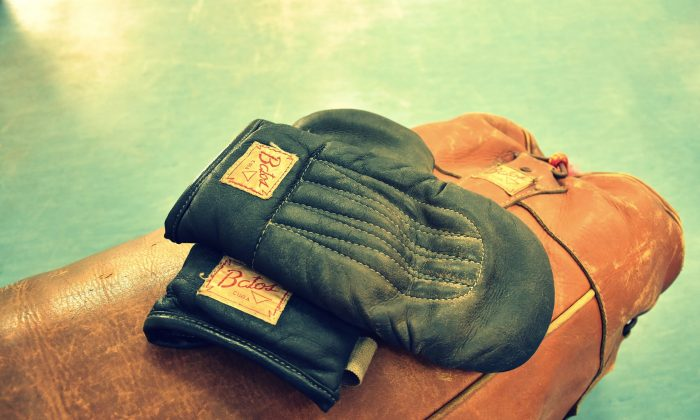 File photo for illustration purposes showing retro boxing gloves on top of a heavy bag. (Pixabay)