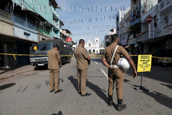 Security personnel observe three minutes of silence