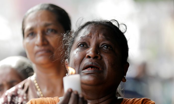 Silence is observed as a tribute to victims, two days after a string of suicide bomb attacks on churches and luxury hotels on Easter Sunday, during a memorial service in Colombo, Sri Lanka, on April 23, 2019. (Dinuka Liyanawatte/Reuters)