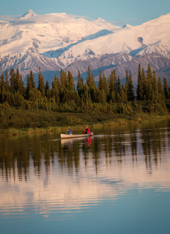Denali National Park visitors paddle through Wonder Lake.