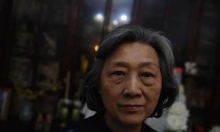 Veteran Chinese journalist Gao Yu poses for a photo at her home in Beijing on March 31, 2016.