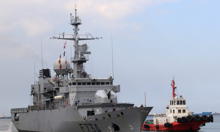 Tugboat escorts French Navy frigate Vendemiaire on arrival for a 5-day goodwill visit at a port in Metro Manila, Philippines on March 12, 2018. (Romeo Ranoco/Reuters)