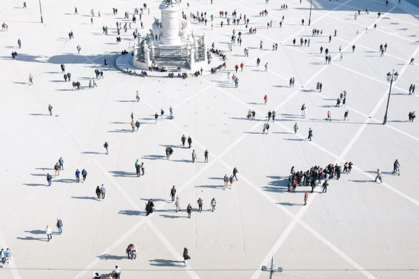 Tourists walk at Comercio square in downtown Lisbon