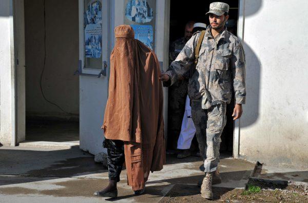burqa-clad Taliban fighter