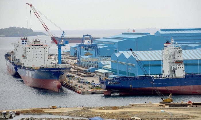 Workers labor at the shipyard of Hanjin Heavy Industries and Construction-Philippines, the local arm of South Korea's Hanjin group in Subic Bay, northwest of Manila, on March 13, 2009. (Jay Directo/AFP/Getty Images)